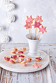 Sweet shell biscuits with cream filling and baked pink magic wands