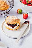 Classic scones with cream and strawberry jam