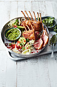 Roasted lamb rack with herb and almond pesto