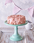 Pink butter and raspberry cream cake
