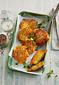 Crispy potato pancakes with smelly surface ripened round cheese