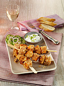 Pumpkin skewers with chicken and sesame seeds