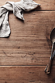 Linen napkin and cutlery on a wooden background