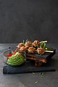 Asian pork and prawn meatballs with avocado dip
