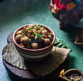 Steamed millet rice savory dumplings (India)