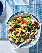 Zucchini salad with 'straciatella', peas and chorizo dressing