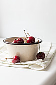 Cherries in an enamel pot