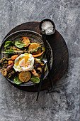 Grilled vegetables with poached egg