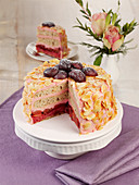 Pink plum cake with mascarpone and almonds