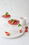 Panna cotta with strawberries and coulis