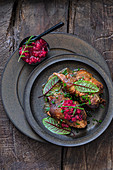 Roasted hamchocks with red currant compote