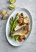 Sea bass fillets with mushrooms and green asparagus