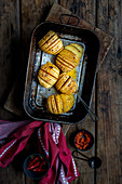 Hasselback potatoes with harissa butter