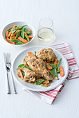Rabbit in mustard sauce with carrots and peas