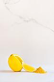 Lemon with wedge and lemon fruit powder