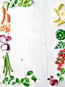 Gemüsestilleben mit Zitronen und Kräutern