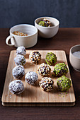 Whiskey orange balls with coconut, pistachios and almonds