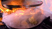 Cooking flambe gyozas in pan