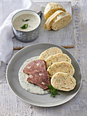 Larded beef with dill sauce and napkin dumplings