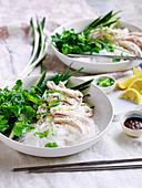 Bang bang chicken salad with herbs and green mung bean noodles
