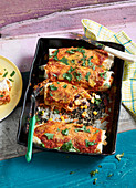 Tex-Mex enchiladas with chicken, corn and beans