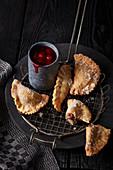 Mini lard ravioli with cherry compote