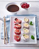 Pancake sushi with fruit and chocolate sauce