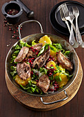 Salat with grilled pork liver and oranges