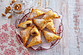 Puff pastries with nuts and plum compote