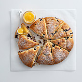 A fruit scone cake with coconut and blueberries