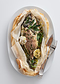 Sea bream with garlic and rosemary cooked in parchment paper