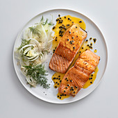 Salmon with fennel salad and a passion fruit and honey sauce