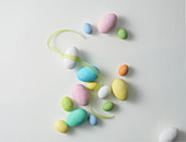 Easter eggs and ribbon on a white surface