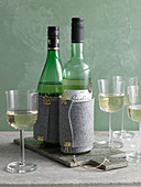 Wine bottles in felt cooling sleeves