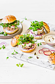 Chicken patty burgers with red onion, radish, microgreen mustard and yoghurt sauce