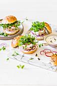 Chicken patty burgers with red onion, radish, microgreen mustard and yoghurt sauce