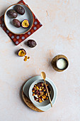 Muesli with nuts and fresh granadilla (passion fruit)