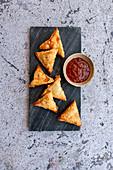 Samosas with sweet chili sauce