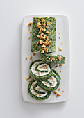 Herb and spinach roll filled with goat's cream cheese and walnuts