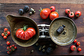 Still life with different types of tomatoes and antique kitchen scales