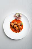 Beef and chorizo balls in tomato Sauce