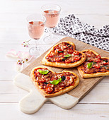 Small pizzas in heart form