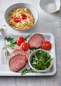 Sirloin with couscous and roasted tomatoes