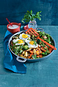 Oven-roasted vegetable salad with fried eggs