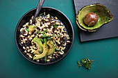 Vegan beluga lentil and wheat salad with avocado and spring onions