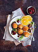 Rice balls with red berry compote