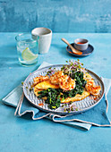 A fluffy omelette with sesame seed prawns, spinach and bean sprouts