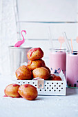 Vegan doughnut balls with blueberry glaze