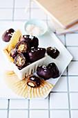 Vegan chocolate-coated nutty dates