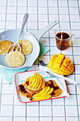Vegan almond 'milk' and mango pikelets